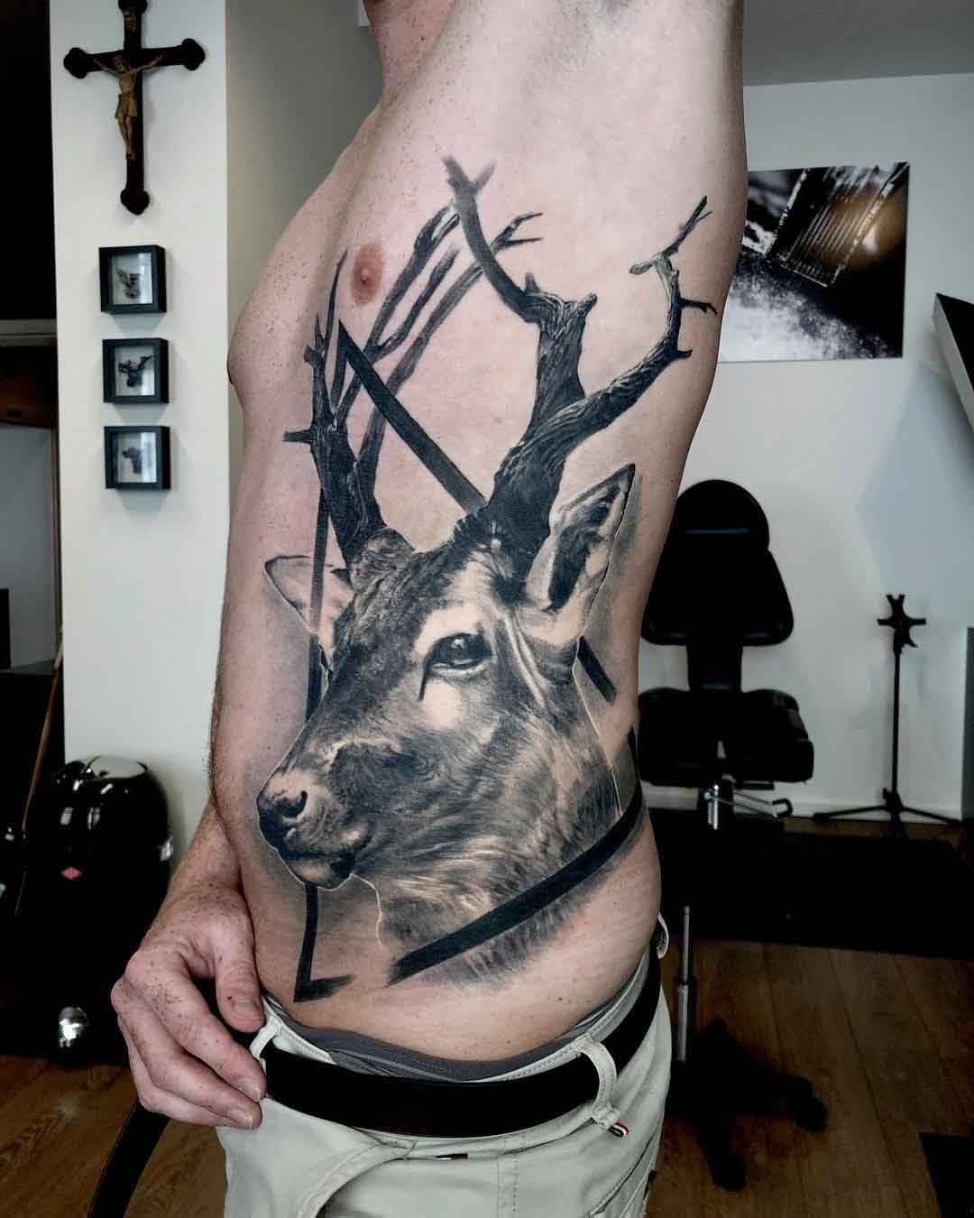 torso side tattoo deer