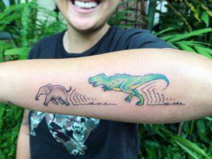 Dino Chasing Elephant Tattoo