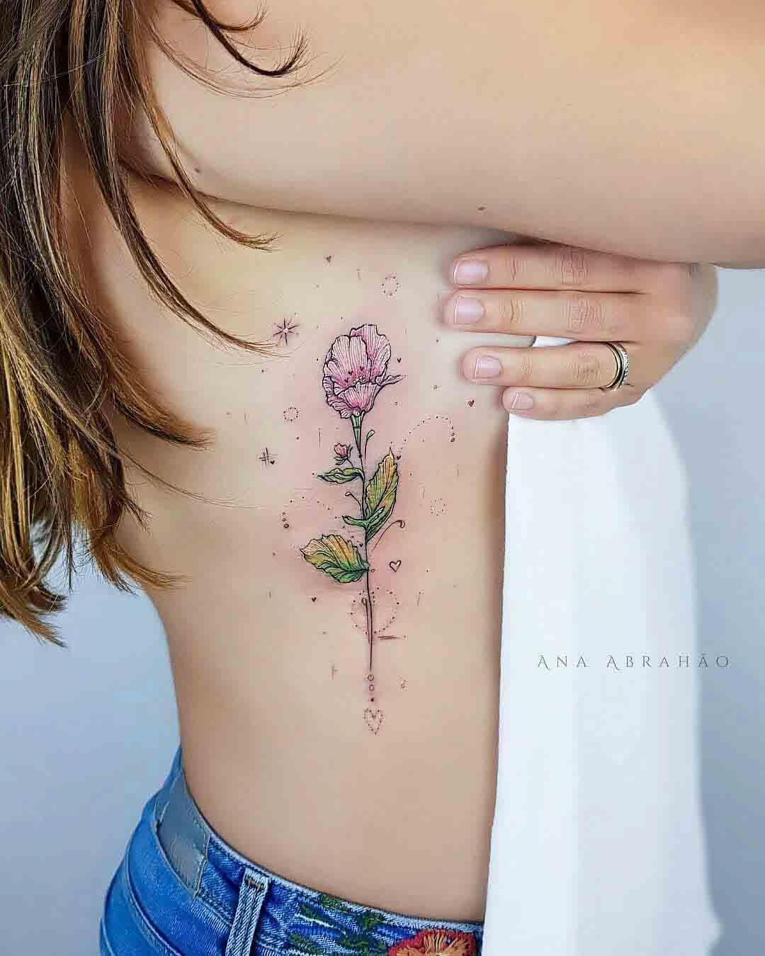 ribs tattoo flower
