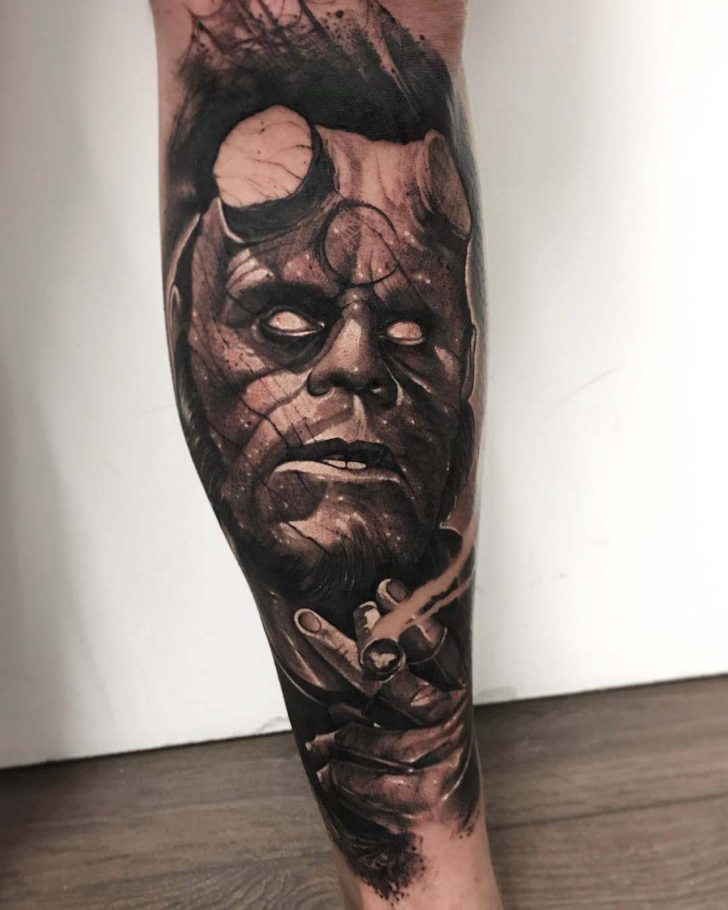 calf tattoo hellboy