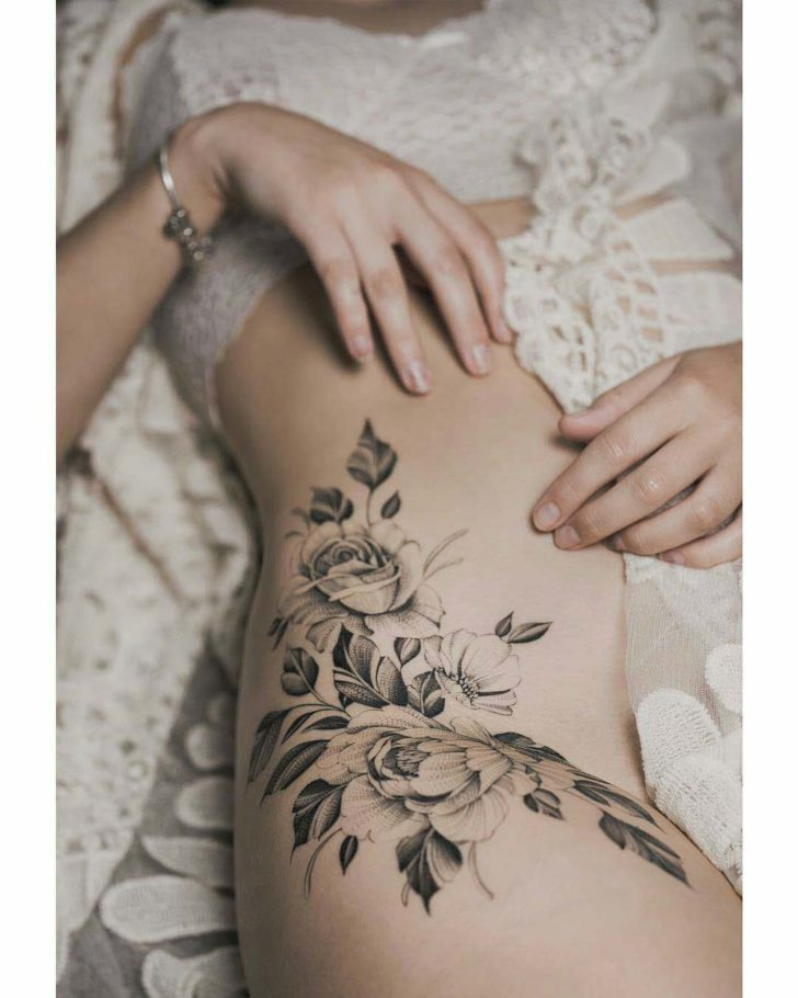 hip and belly side roses tattoo