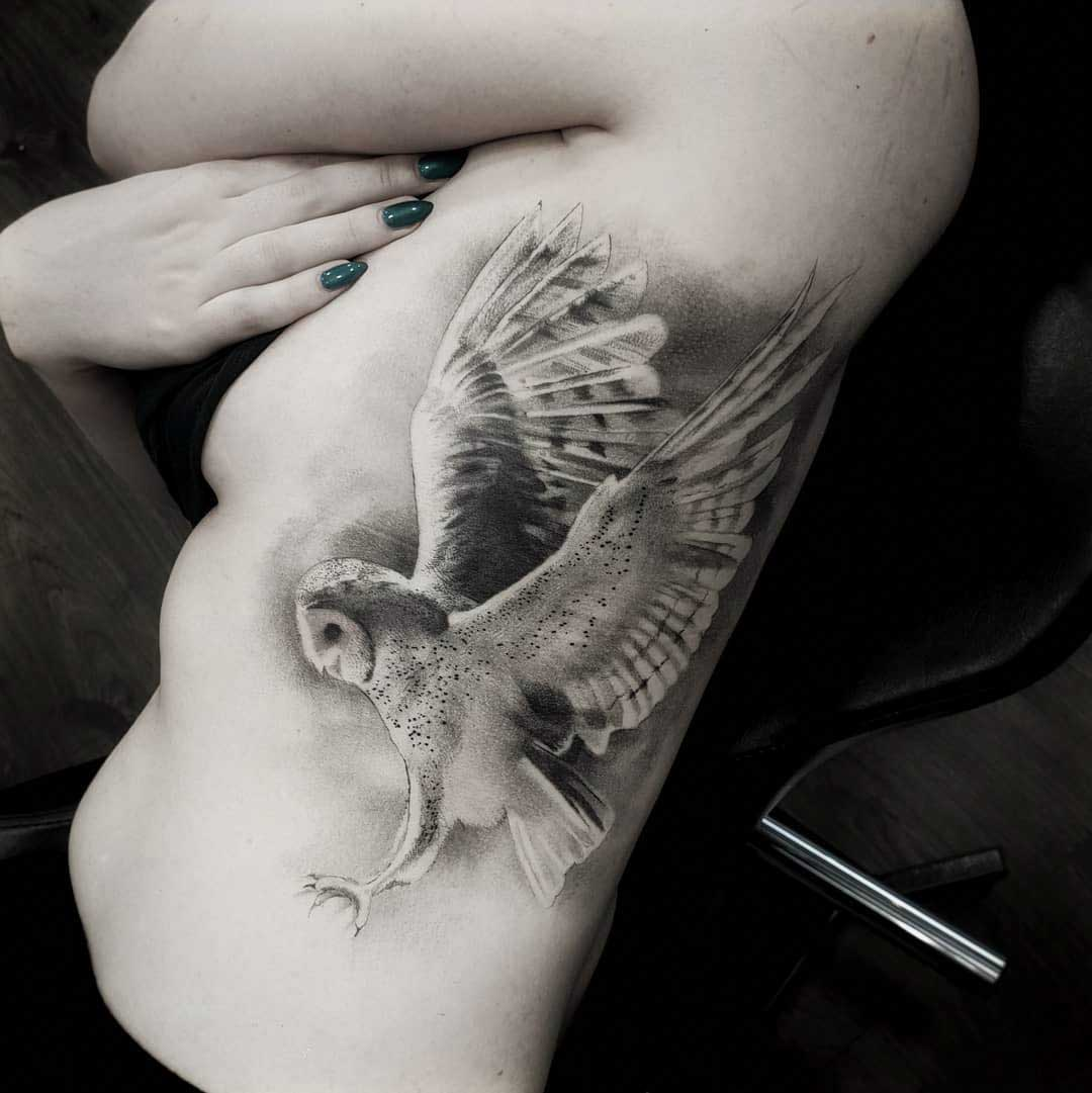 owl tattoo on ribs
