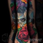 Polygonal Sull and Rose Tattoo