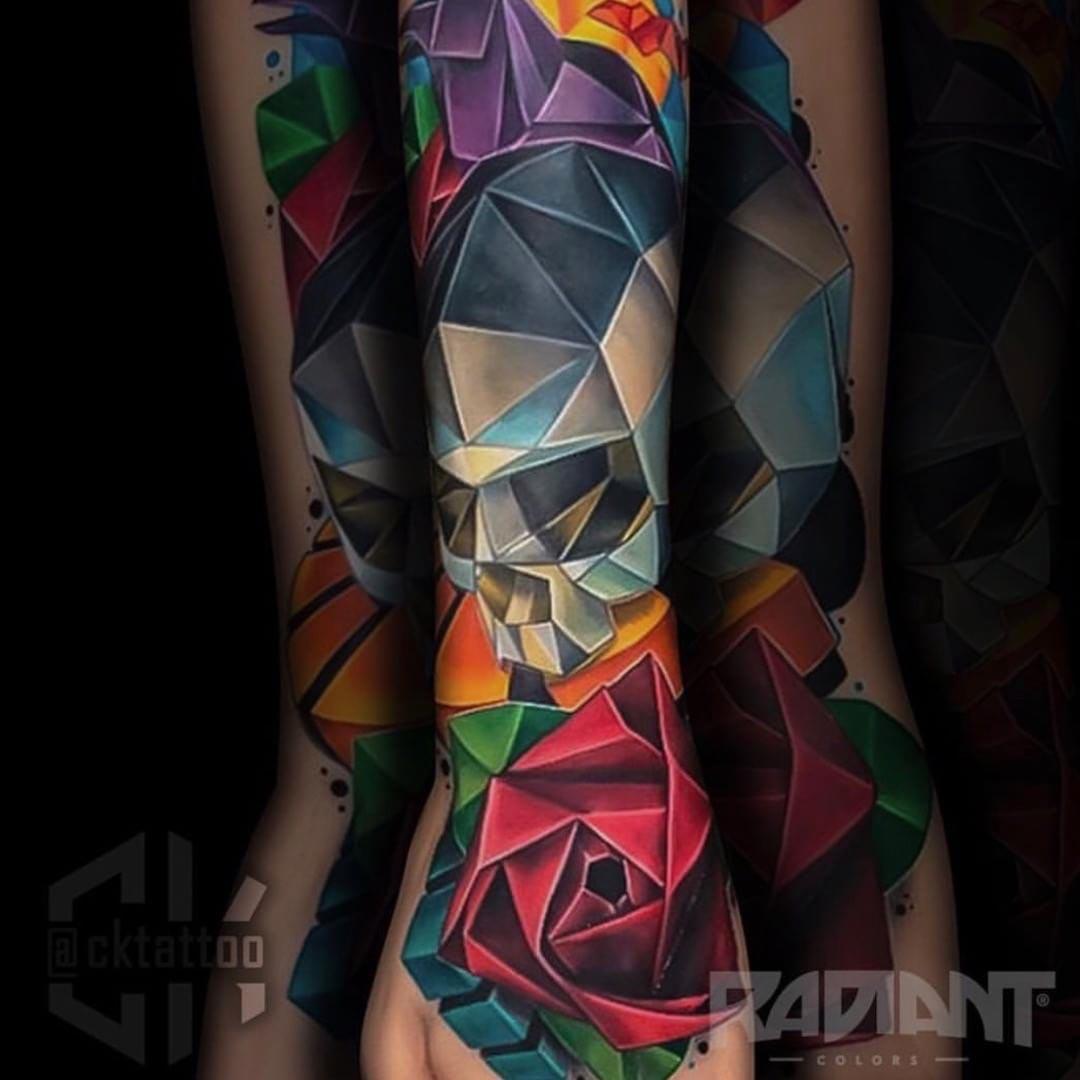 skull and rose polygonal tattoo