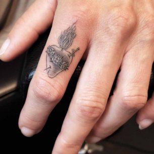 Sacred Heart Tattoo on Finger