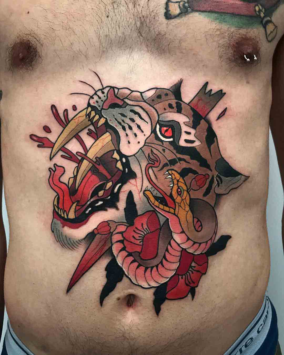 neo-traditional tattoo on stomach snake and tiger/caugar