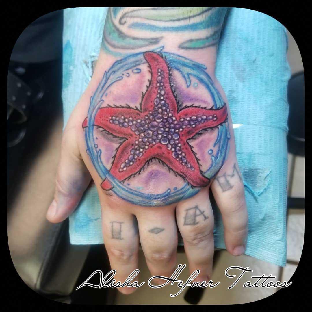 hand tattoo starfish