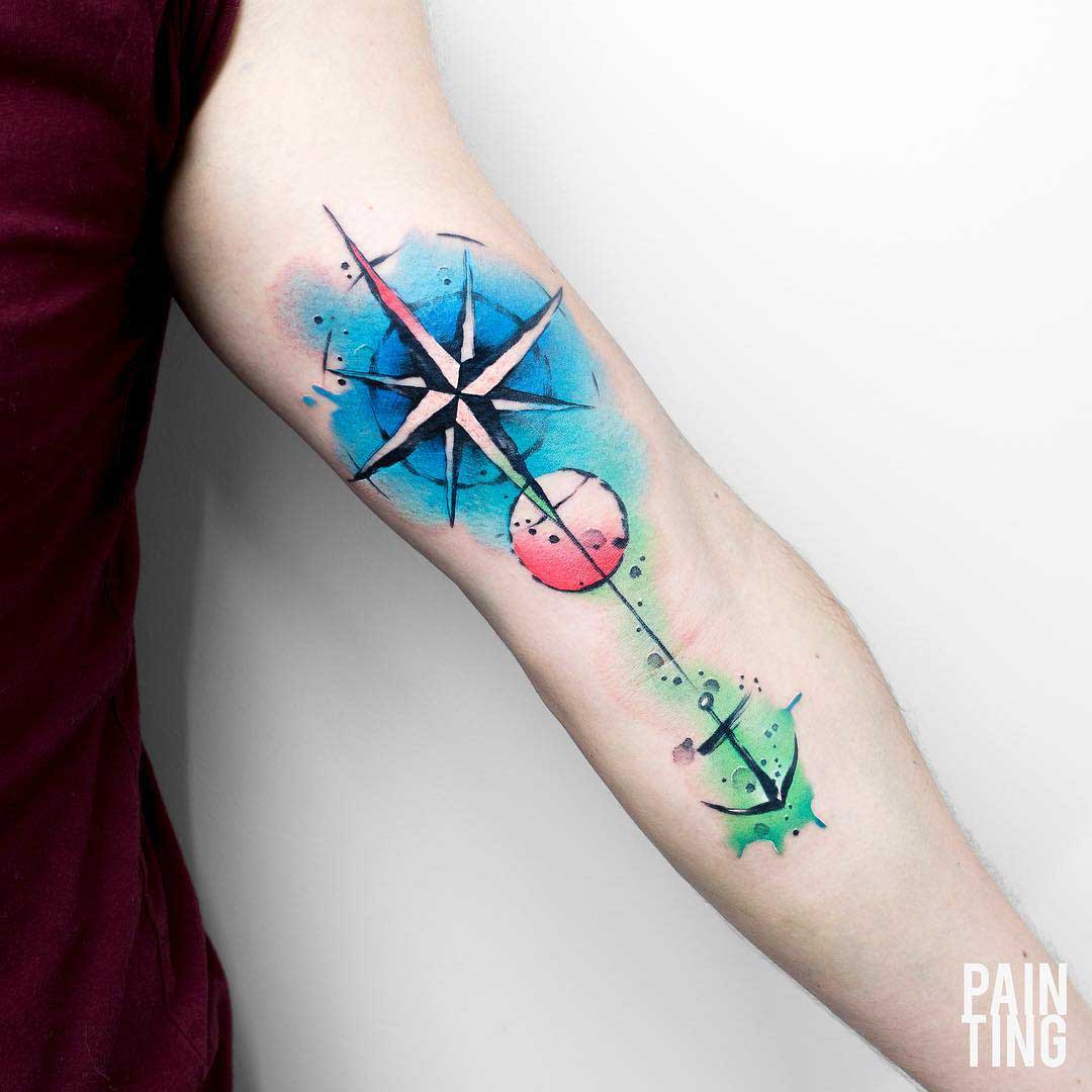 arm tattoo anchor and star
