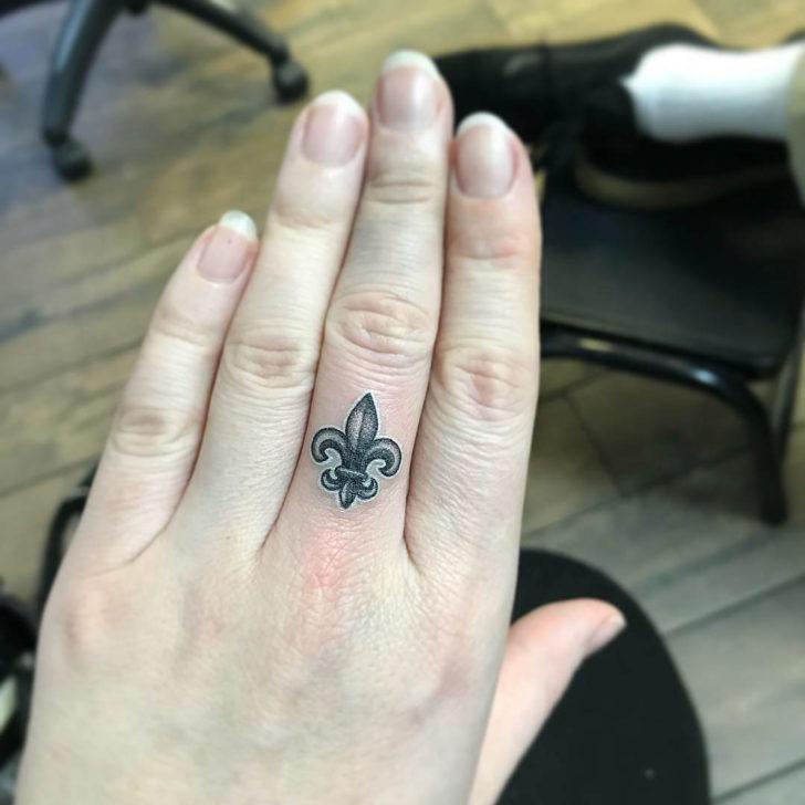 Fleur De Lis Tattoo on Finger