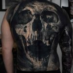 Reaper's Face Tattoo on Back