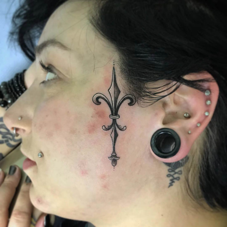 Side Face Fleur De Lis Tattoo