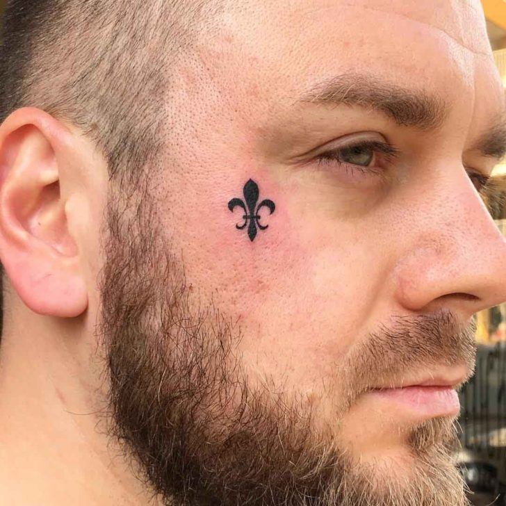 Small Fleur De Lis Tattoo on Face