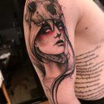 Girl in Skull Tattoo on Shoulder