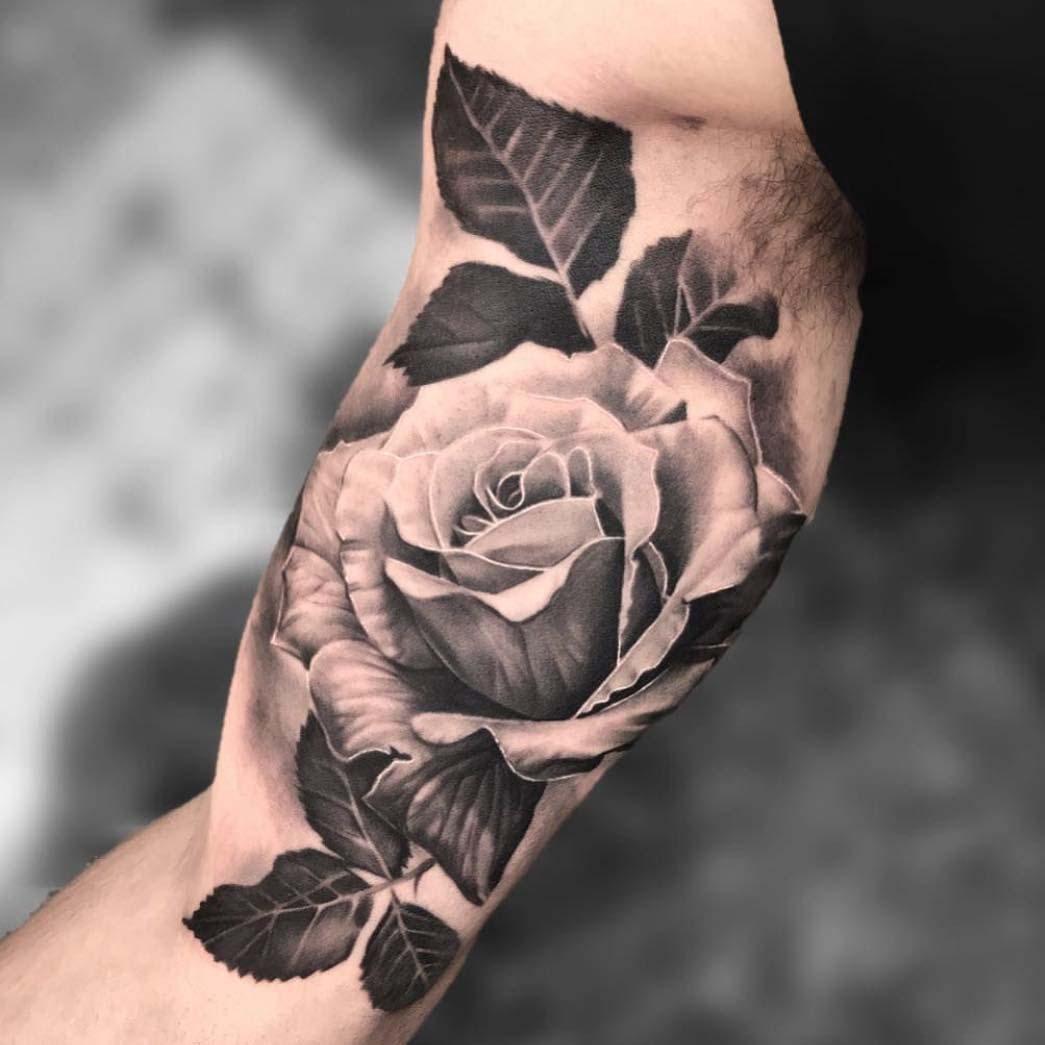 rose tattoo on innder bicep