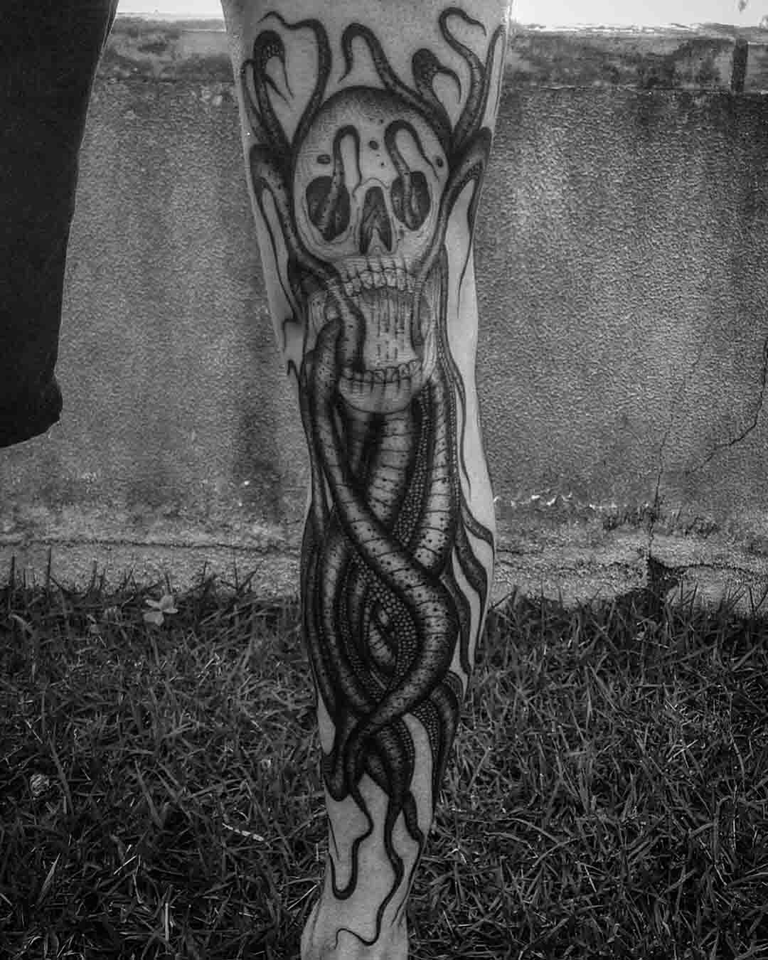 leg tattoo octopus skull