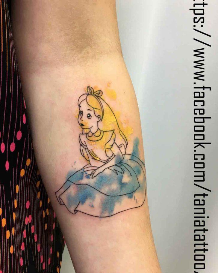 arm tattoo alice in wonderland