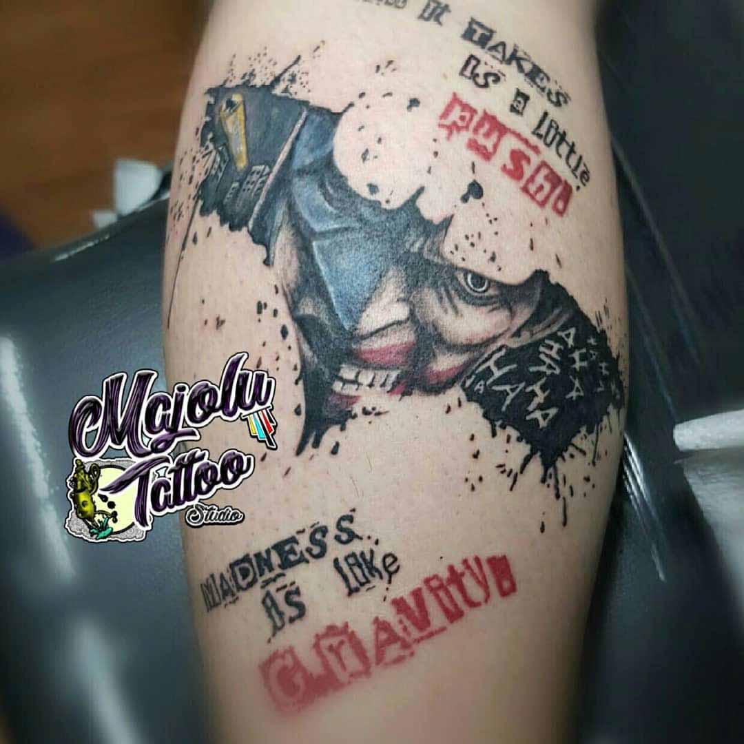 calf tattoo bat sign Joker