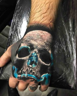Blue Glow Skull Tattoo on Hand