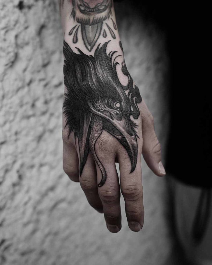 hand tattoo crow