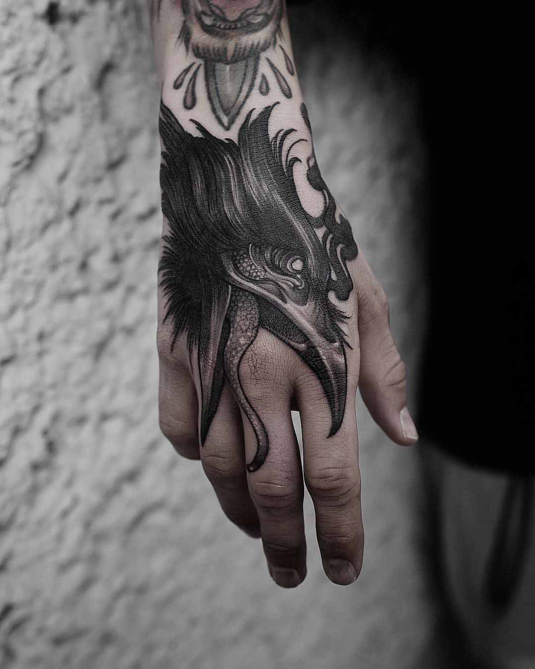 hand tattoo crow