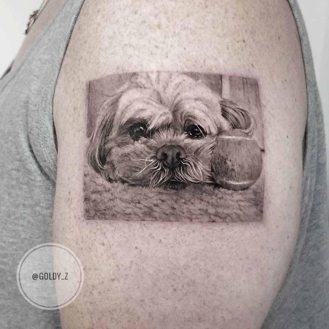 shoulder tattoo sad dog