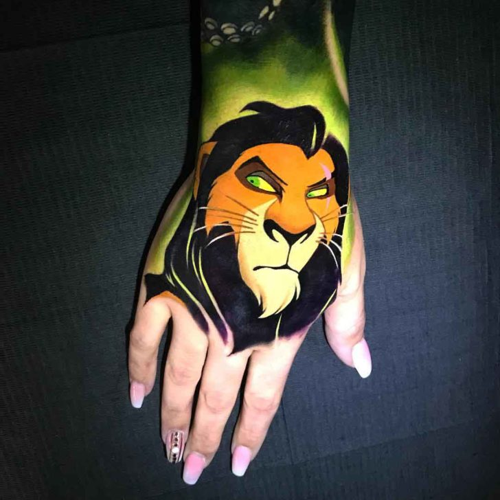 thi lion king scar tattoo on hand