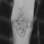 Middle Chest Heart Tattoo