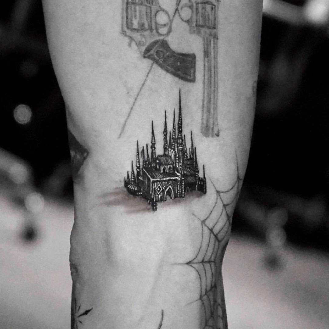 very small castle tattoo