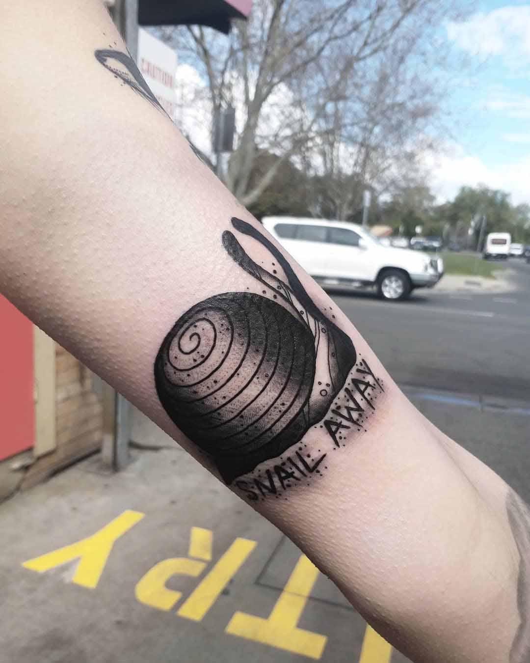 arm snail tattoo