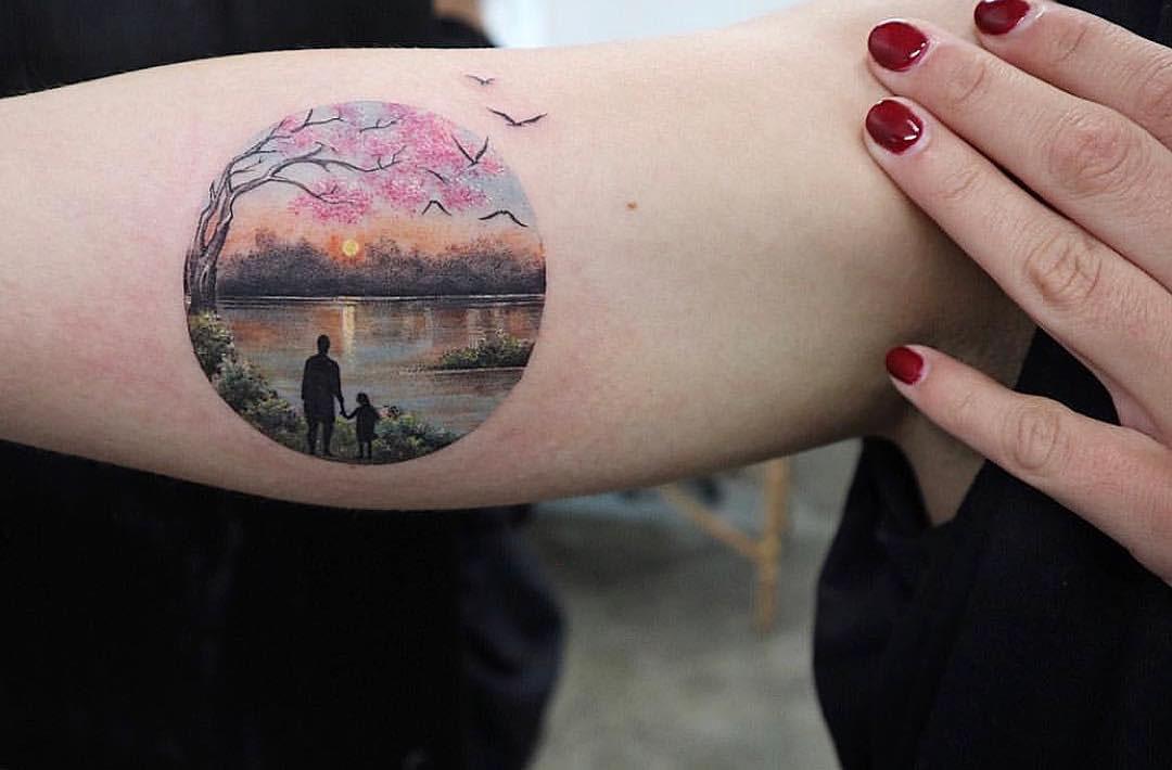 sunset landscape tattoo