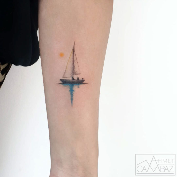 small ship tattoo on arm
