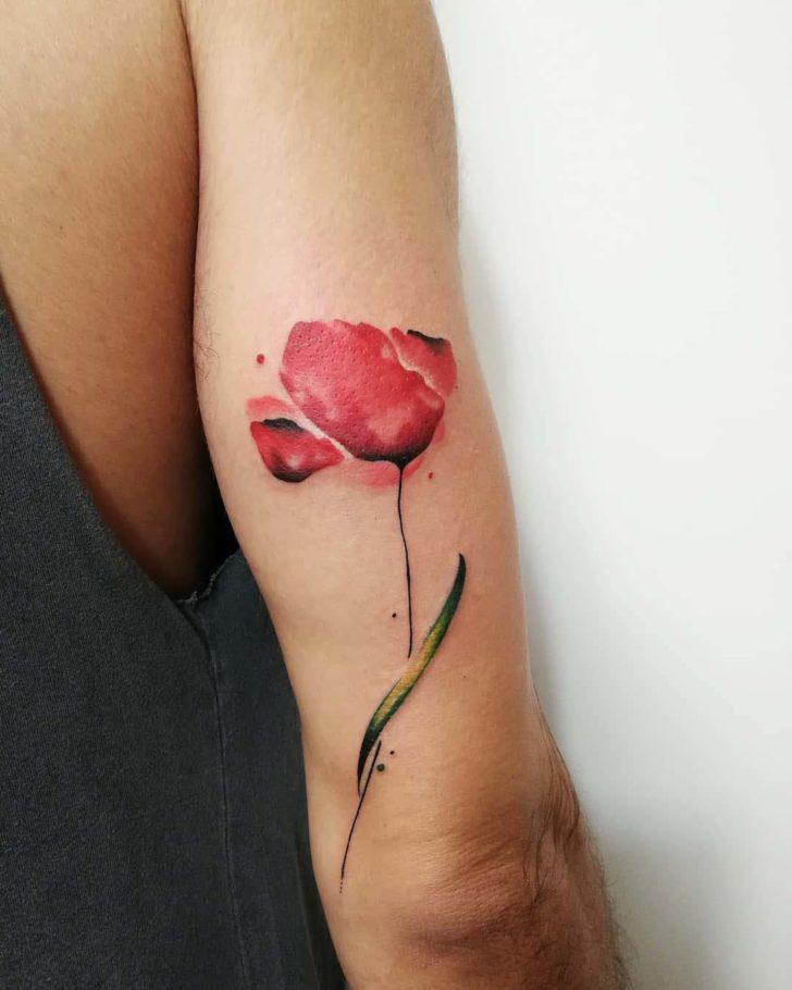 poppy tattoo on arm