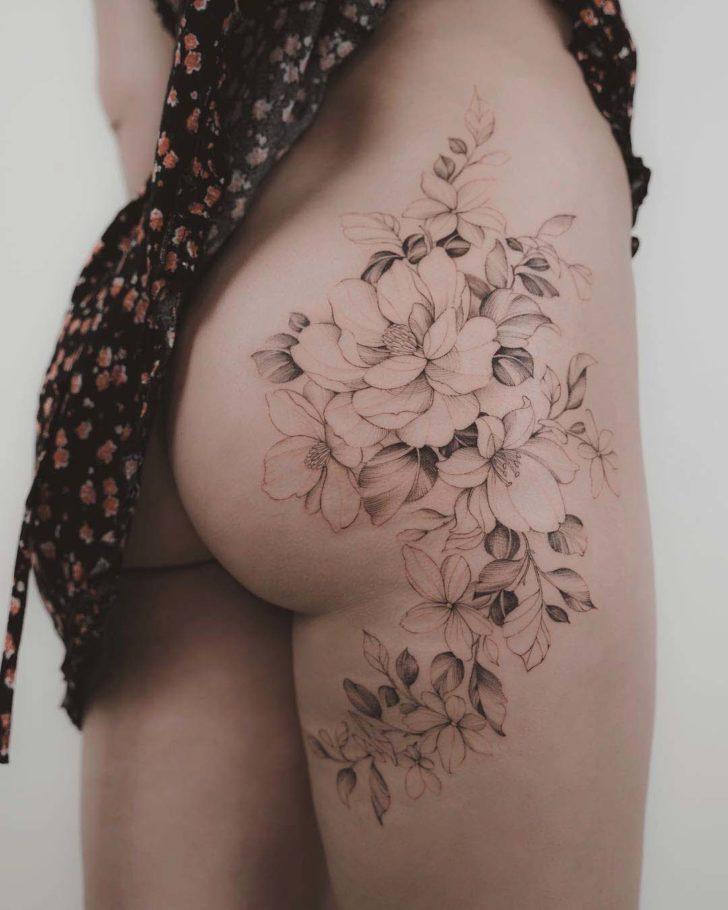 hip tattoo flowers