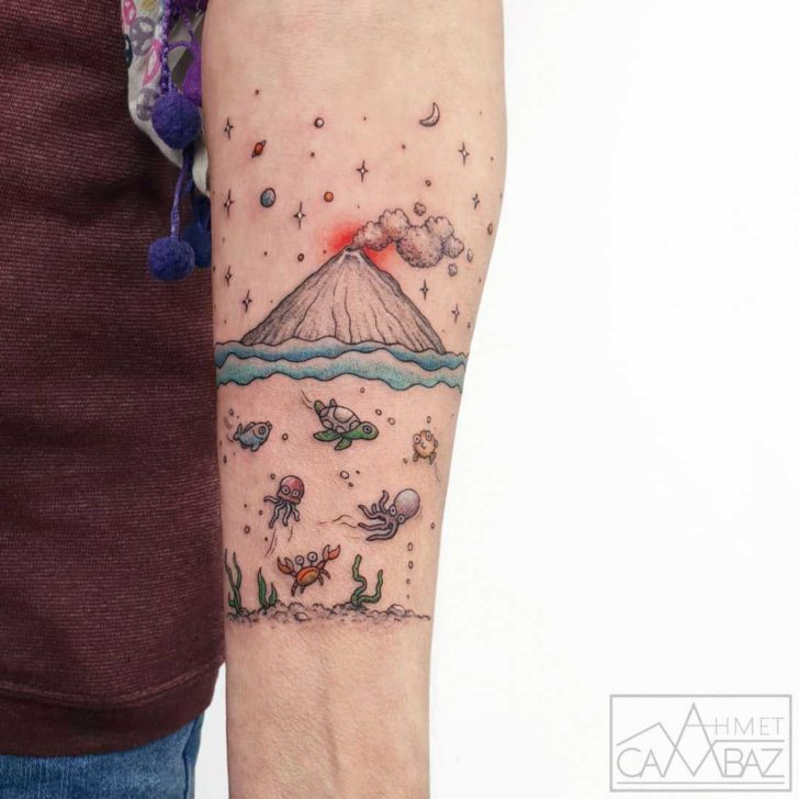front bicep tattoo volcano