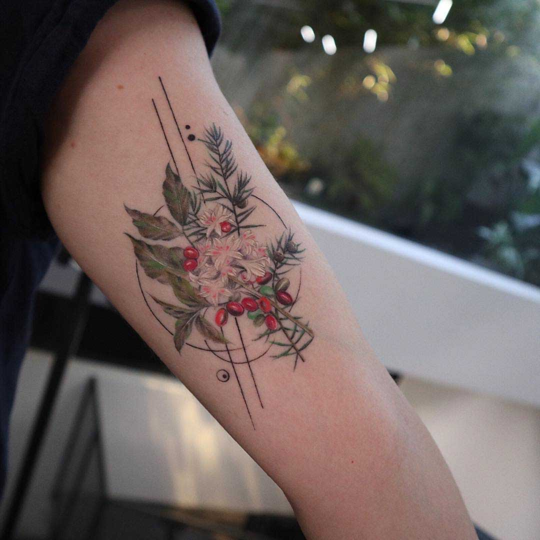 arm tattoo berries