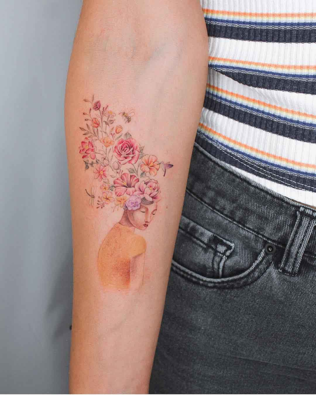 arm tattoo flowers girl