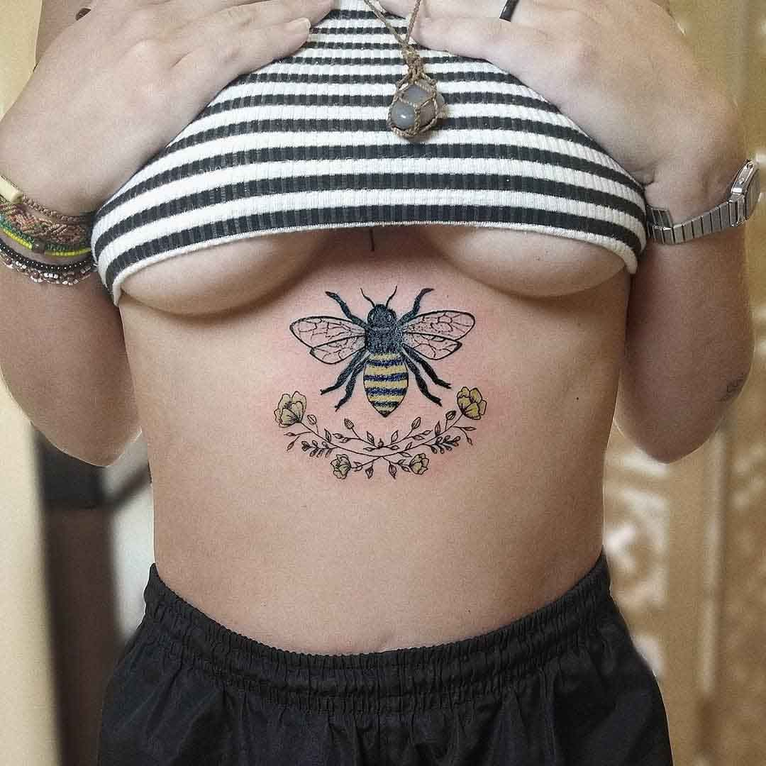 bee tattoo underboobs