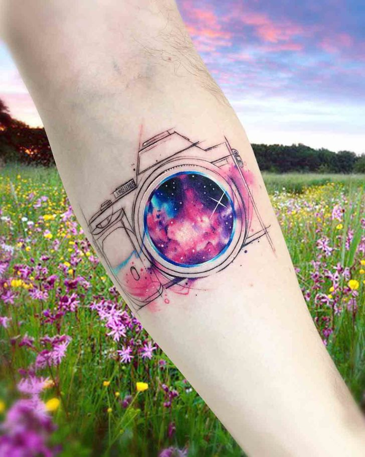 arm tattoo camera universe lens