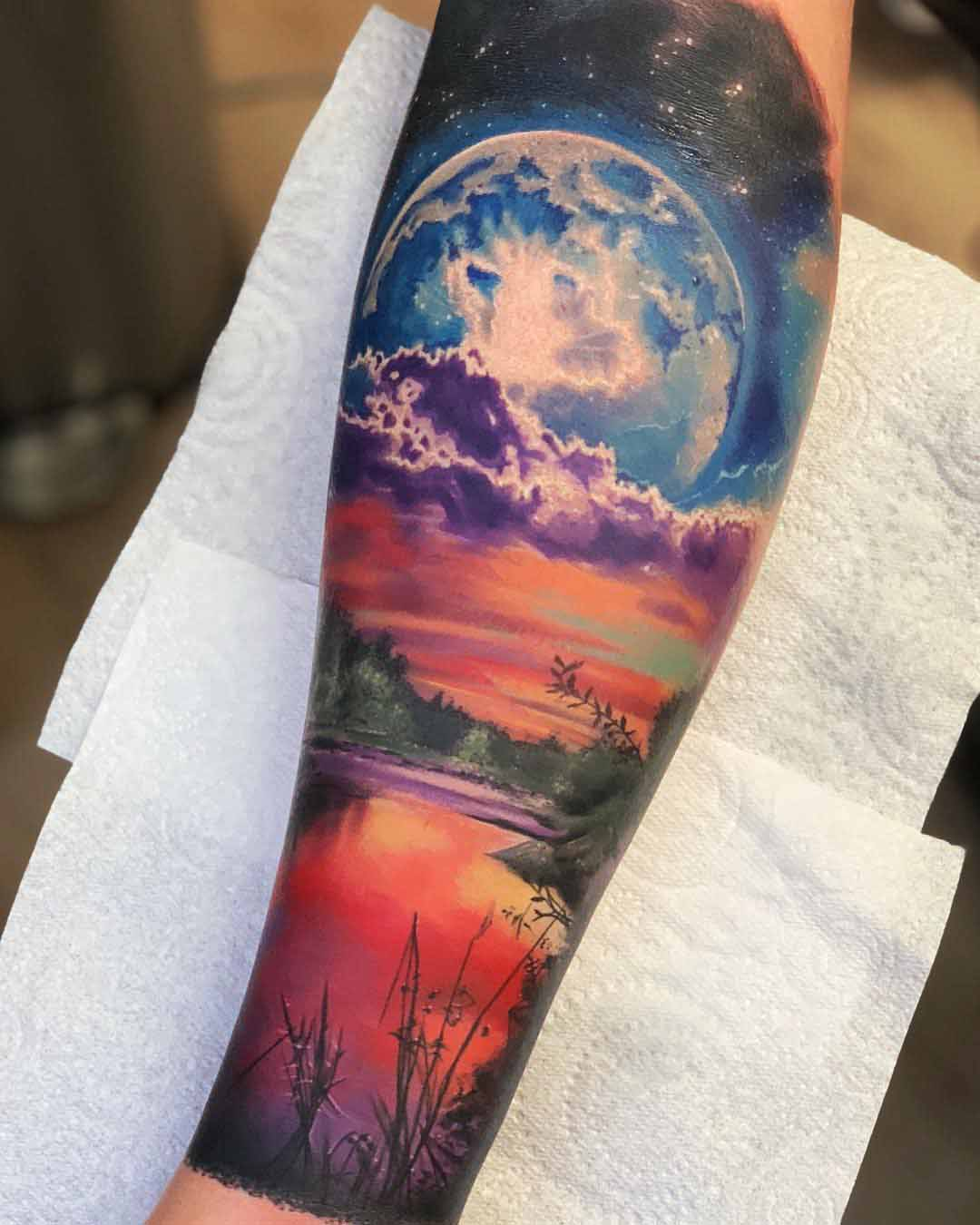 sunset planet landscape tattoo
