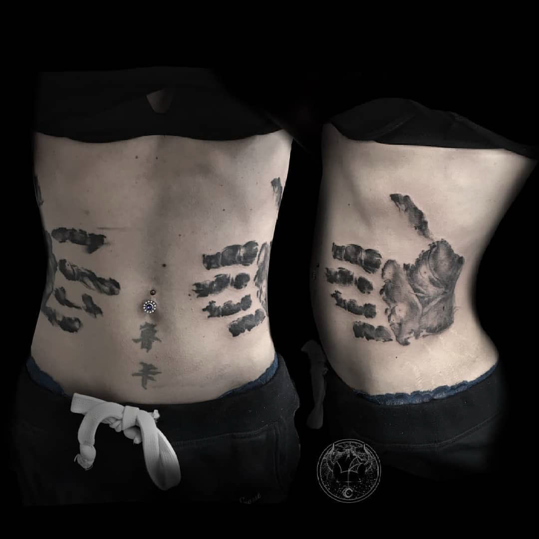 stomach tattoo handprint