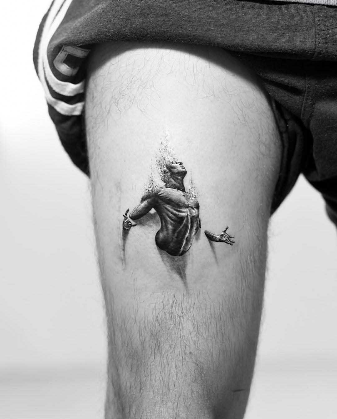 thigh tattoo man