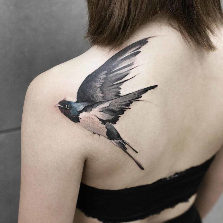 shoulder blade tattoo swallow