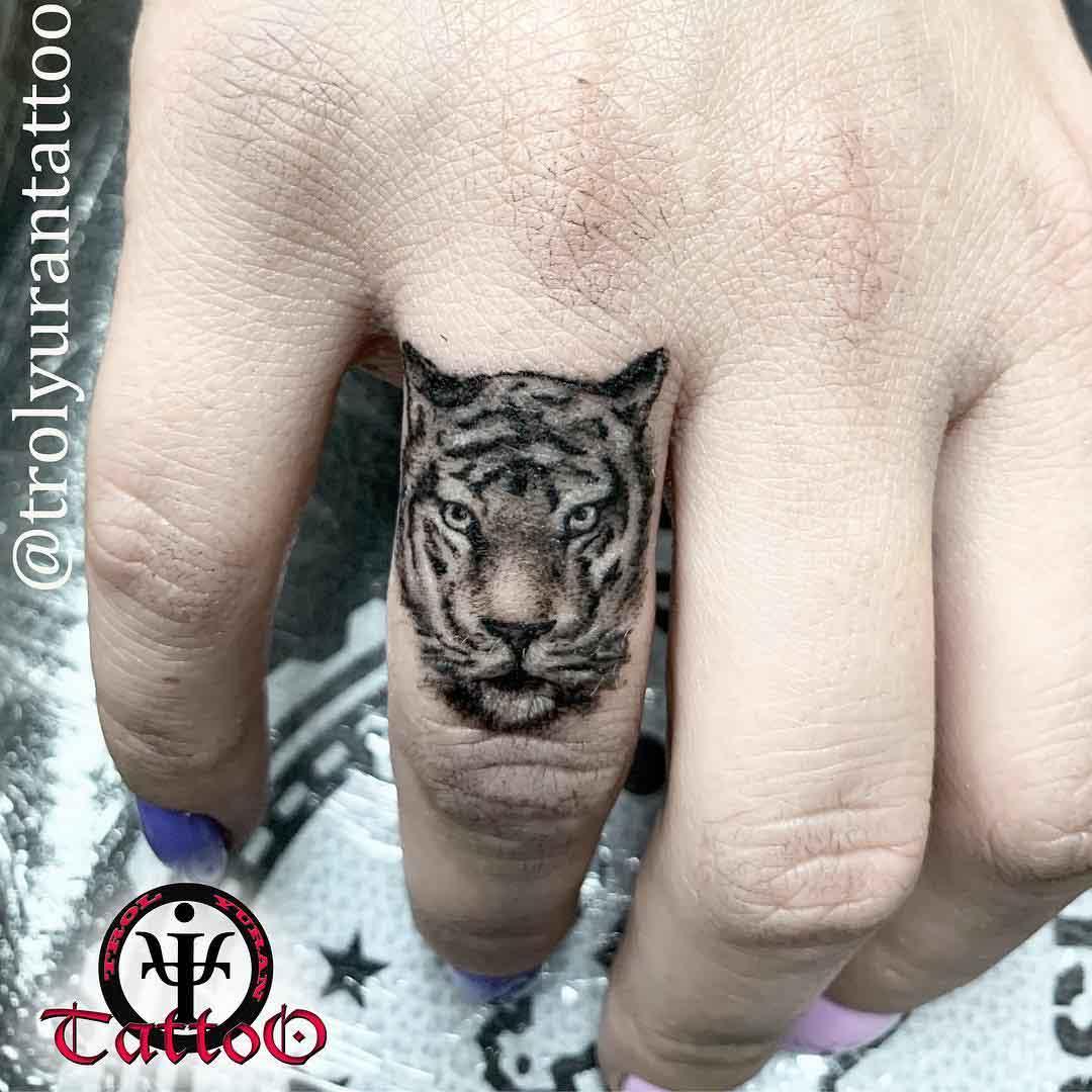 tiger tattoo on finger