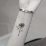 Transparent Rose Tattoo on Wrist