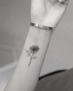 Transparent Rose Tattoo on Wrist