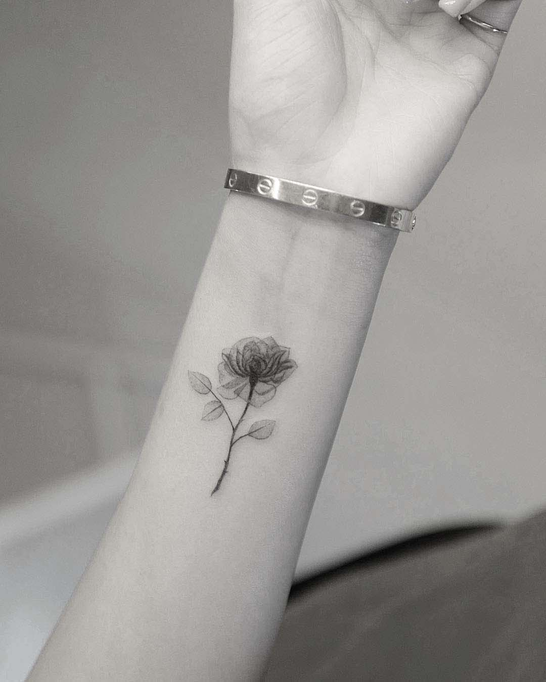wrist flower tattoo rose