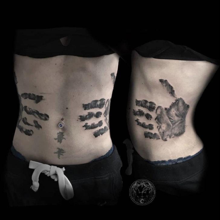 stomach tattoo handprint