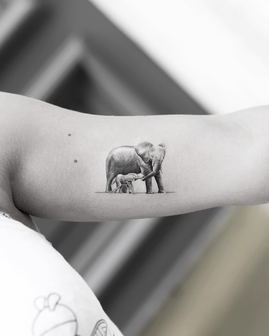 bicep tattoo elephants